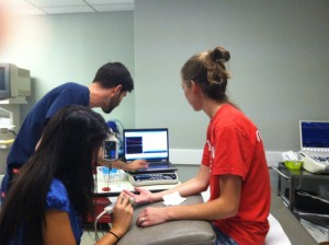 VCOM students practicing nerve conduction studies on each other